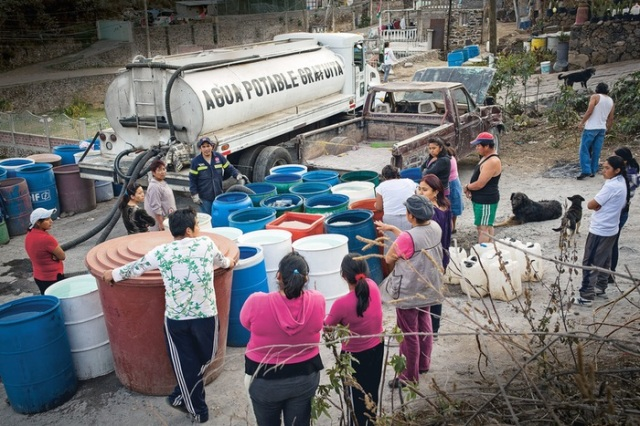City residents waiting to fill their water drums from a water trucks.